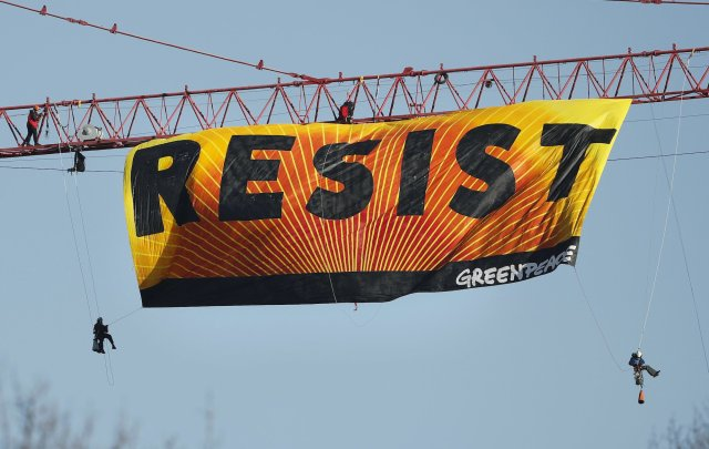 Greenpeace protestors send a message to America near the White House. Don't try this at home.